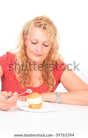 A Hungry gluttonous woman eating cake