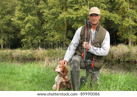 A hunter and his dog. - stock photo