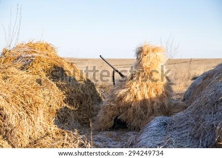 a hunter in ambush - stock photo