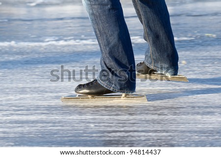 A ice skater is skating on the famous dutch Bonkevaart (Friese Elfstedentocht) - stock photo