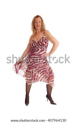 A image of a happy blond woman standing from the front, lifting up