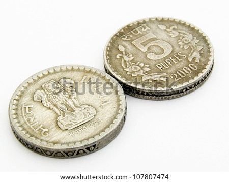 A image showing 5 rupees old used indian coins with head & tail side on isolated white background. - stock photo