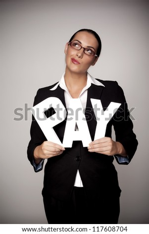 A income concept image of a woman holding letters that spell out the word pay demonstrating fare pay for woman. Income for woman. - stock photo