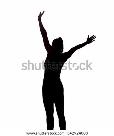 A isolated black and white shot of a woman with her arms in the air