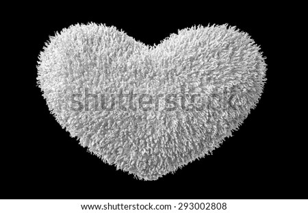 A isolated white plush  heart on black background - stock photo