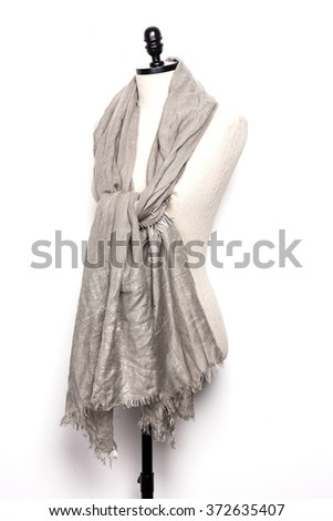 A ivory(golden) scarf with mannequin isolated white.