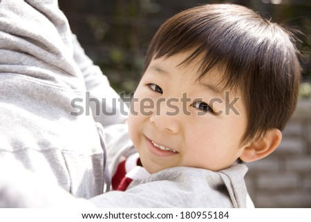 a Japanese child in her mother's arms