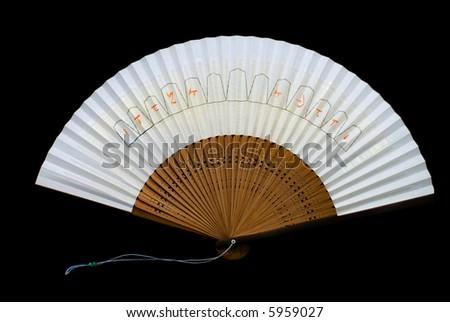 A Japanese fan on black background. - stock photo