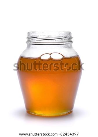 A jar full of honey. Isolated on white background. - stock photo