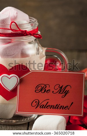 A jar of colored marshmallows on wooden background. Saint Valentine day concept. Love idea. - stock photo