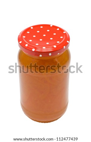 A jar of homemade seville orange marmalade isolated on a white background