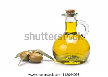 A jar with olive oil and some green olives isolated over a white background. - stock photo