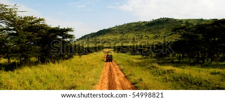A jeep traveling on a dirt road in africa