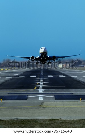A jet is taking off at the airport - stock photo