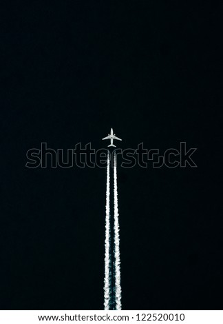 A jet plane flying high in the sky. - stock photo