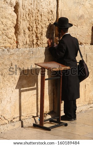 A jew man praying at the Western Wall in Jerusalem - stock photo