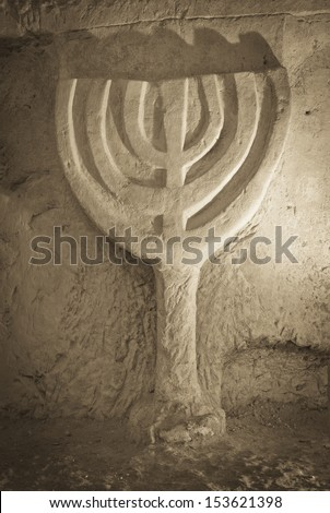 a jewish Menorah rock carved at the necropolis of beit shearim, Israel - stock photo