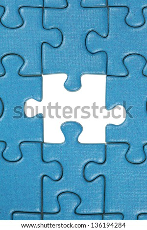 A jigsaw puzzle with the a missing piece - stock photo
