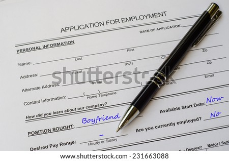 A job application jobs sitting with a pen, applying for a boyfriend - stock photo
