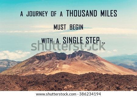 A journey of a thousand miles must begin with a single step. Inspirational motivating quote on blue cloudy sky background and volcano mountain. Vibrant multicolored outdoors horizontal filtered image - stock photo