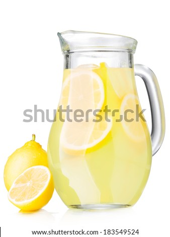 A jug of lemonade with lemon slices isolated on white