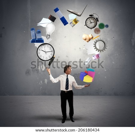 A Juggler businessman play with business objects