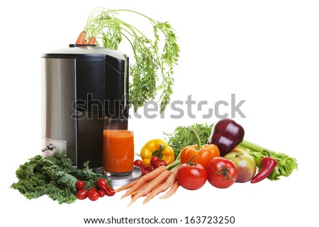A Juicer surrounded by healthy vegetables and fruit, isolated on white.                    - stock photo