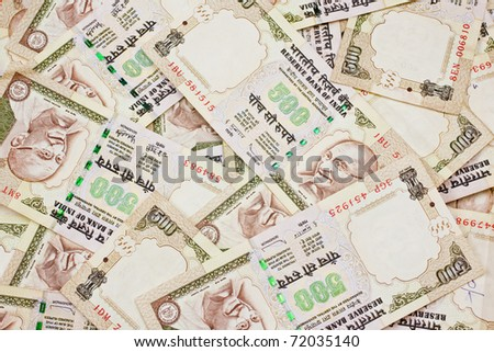 A jumbled pile of Indian five hundred rupee notes. - stock photo