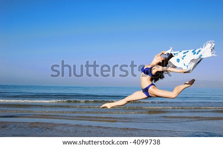 a  jumping girl in bikini at the sea