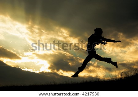a jumping girl on the sunset background