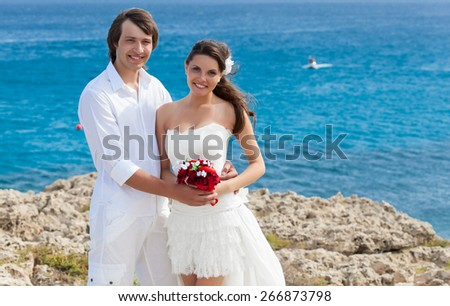 A just married  beautiful couple on the sea beach  - stock photo