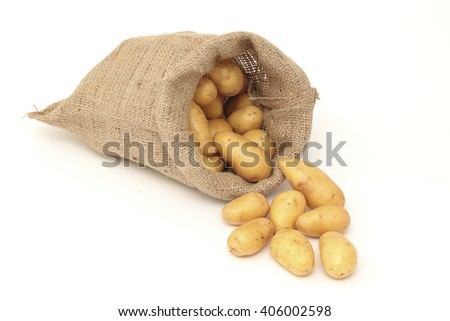 A jute bag filled with potatoes - stock photo