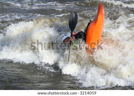 "A kayaker playing in ""The muncher"" at the National Student Rodeo at Nottingham, GB."