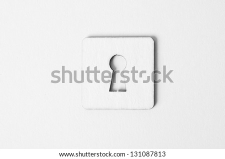 a key and paper keyhole