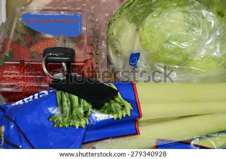 A key left with the produce.  This could be in a store, or a home, a concept for misplacing items and memory loss. - stock photo
