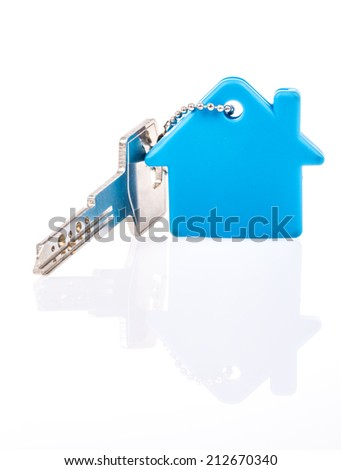 a key with house shaped keyring on white - stock photo