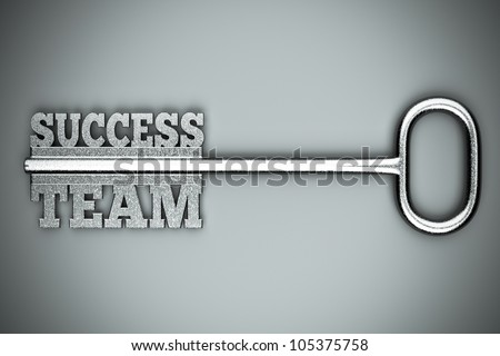 "a key with words ""team"" and ""success"", business concept - stock photo"