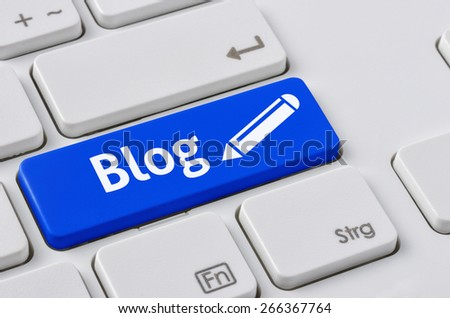 A keyboard with a blue button - Blog - stock photo