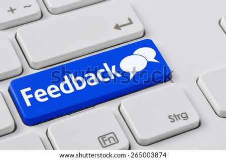 A keyboard with a blue button - Feedback - stock photo