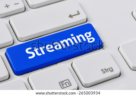 A keyboard with a blue button - Streaming - stock photo