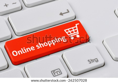 A keyboard with a red button - Online Shopping - stock photo