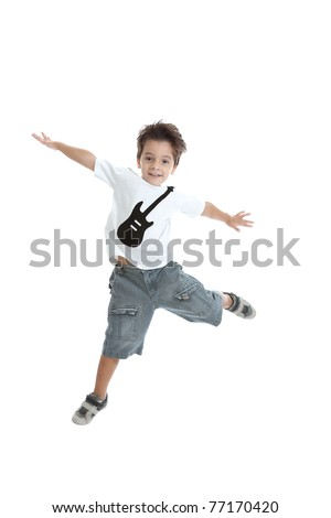 A kid jumping in the air, with a nice tshirt with a guitar painted on it. Isolated on white.