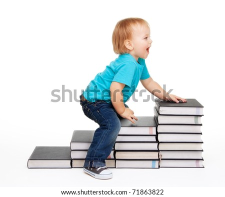 A kid sitting on a steps of books, isolated on white - stock photo