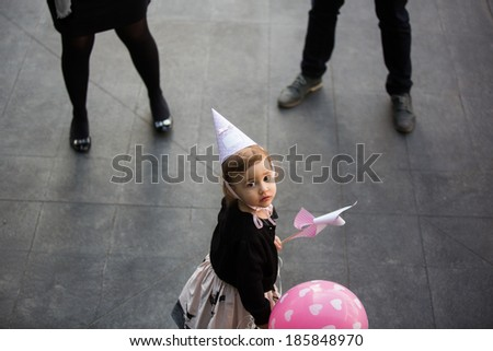 A kid standing in between divorced parents. Difficult childhood concept - stock photo