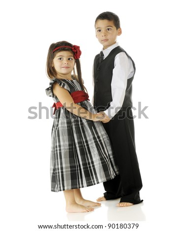A kindergarten boy preparing to dance with his preschool partner.  On a white background.