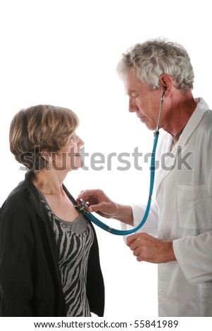 a kindly doctor checks his patient for a heartbeat - stock photo