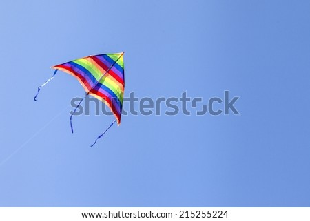 A kite isolated on a clear and blue sky - stock photo