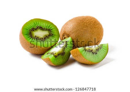 A kiwi fruit sliced and a kiwi fruit unharmed isolated on white background
