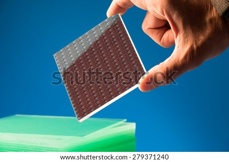 A lab on chip is device integrates several laboratory processes in one device, mostly LOC based on glass plate - stock photo