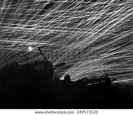 A lacework of anti-aircraft fire by the Marine defenders of Yontan airfield, on Okinawa. Firing is at Japanese night air raiders. Ca. May 23- June 22, 1945. - stock photo